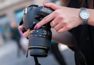 Photo of a person holding a camera