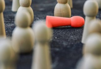 Photo of a game where many figures are standing up and one is knocked over