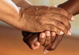 Photo of hands clasped together