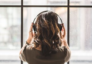 Photo of a person listening to music with headphones