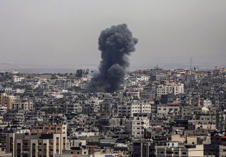 Smoke rises after Israeli airstrikes on Gaza City, the Gaza Strip, Palestine, May 12, 2021.