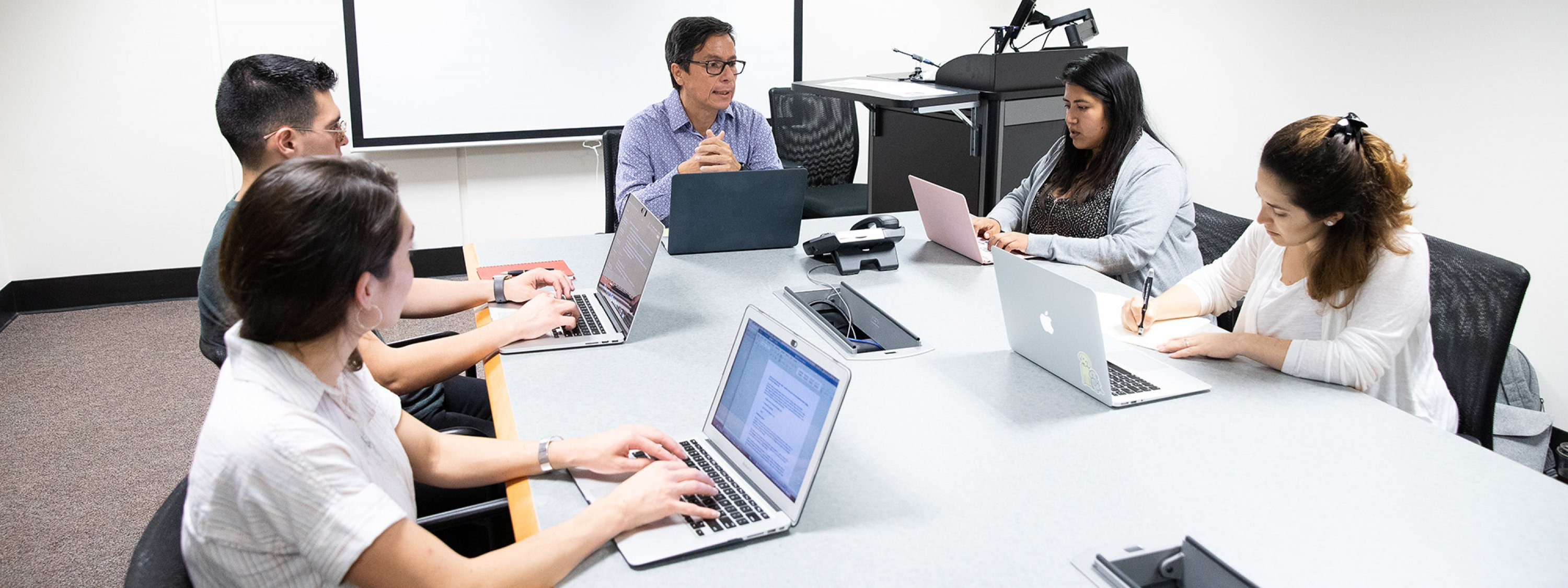 Image of students using laptops in a study room