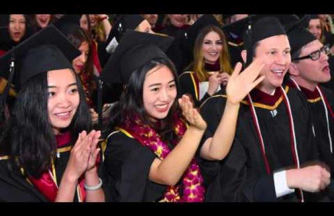 Dean Wilson congratulates the USC Annenberg class of 2016