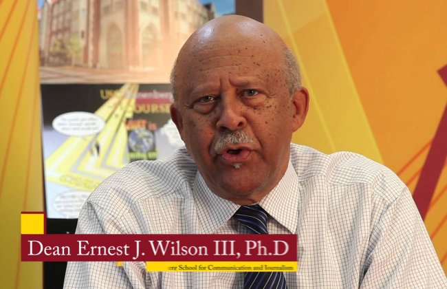 Dean Wilson congratulates the USC Annenberg class of 2015
