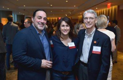 Photo of three alumni