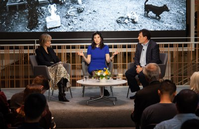 Photo of Dean Willow Bay moderating a discussion with Nicholas Kristof and Sheryl WuDunn