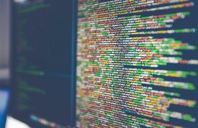Photo of computer code on a desktop
