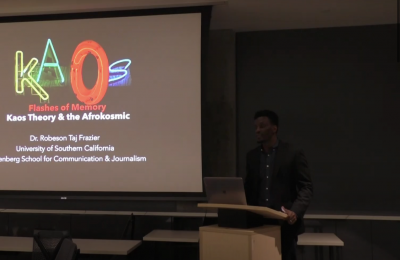 Image of Robeson Taj Fraizer presenting on the Kaos Theory and Afrokosmic
