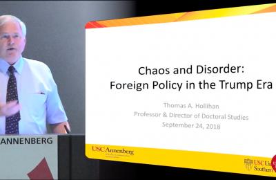 Photo of a presentation by Thomas Hollihan