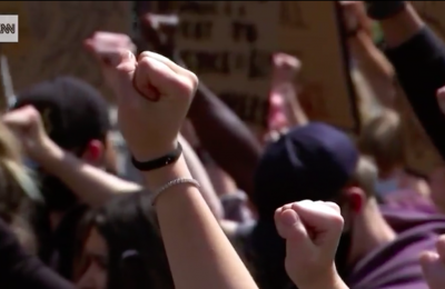 Photo of many fists in the air