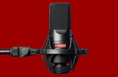 """Photo of a microphone that says """"podcast"""" on it"""