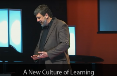 Photo of a presentation by Douglas Thomas on a New Culture of Learning