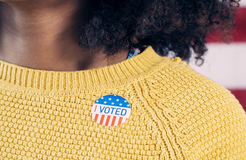 """Photo of a person with an """"I voted"""" sticker"""
