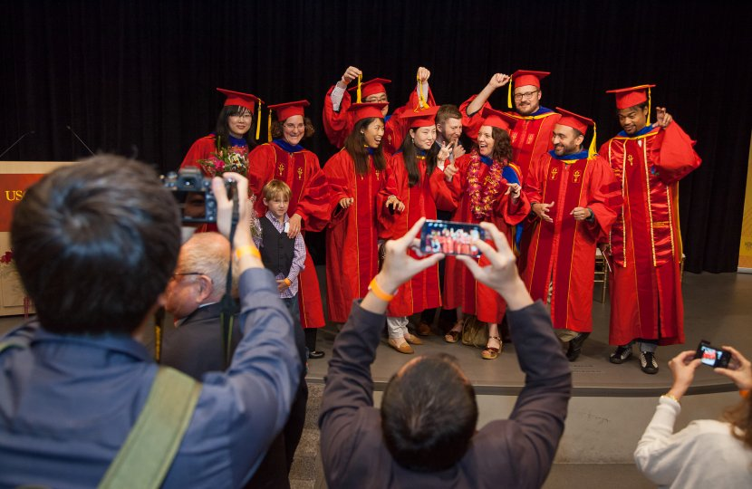 Ph.D. graduates pose for photographs for their family and friends after receiving their degrees on May 14, 2105 at the USC Annenberg School for Communication Doctoral Hooding Ceremony.