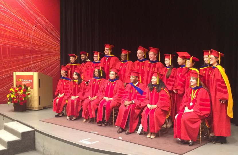 Ph.D. graduates pose after the 2016 hooding ceremony in Wallis Annenberg Hall.