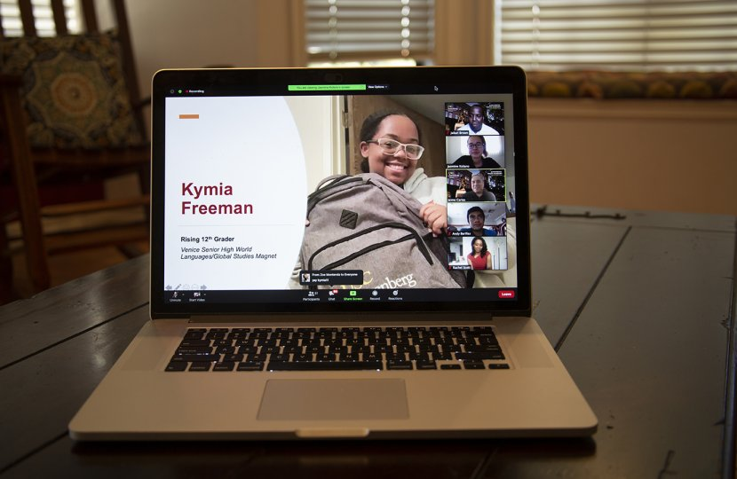 Photo of a laptop with Kymina Freeman on the screen