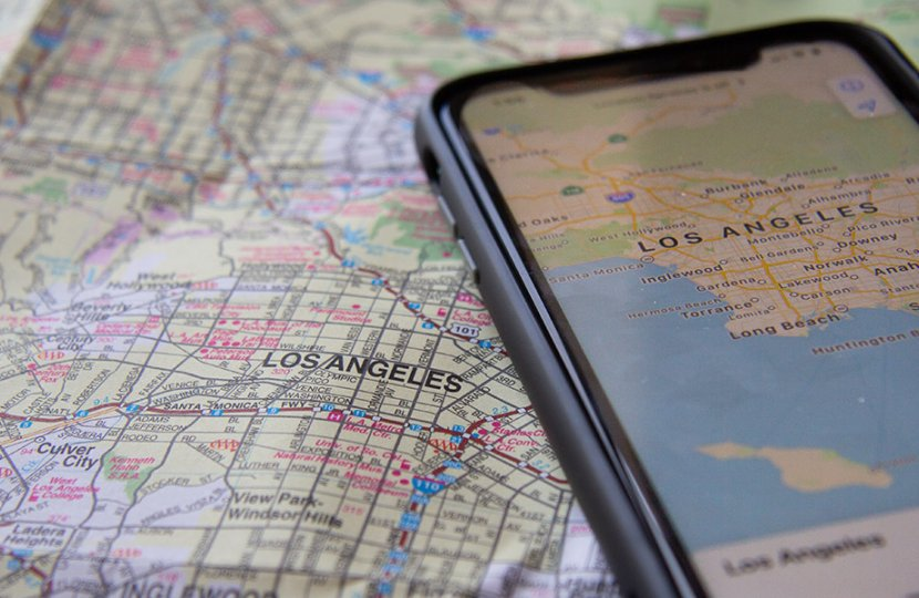Photo of a Los Angeles map with a gps of a smartphone of Los Angeles also on the map