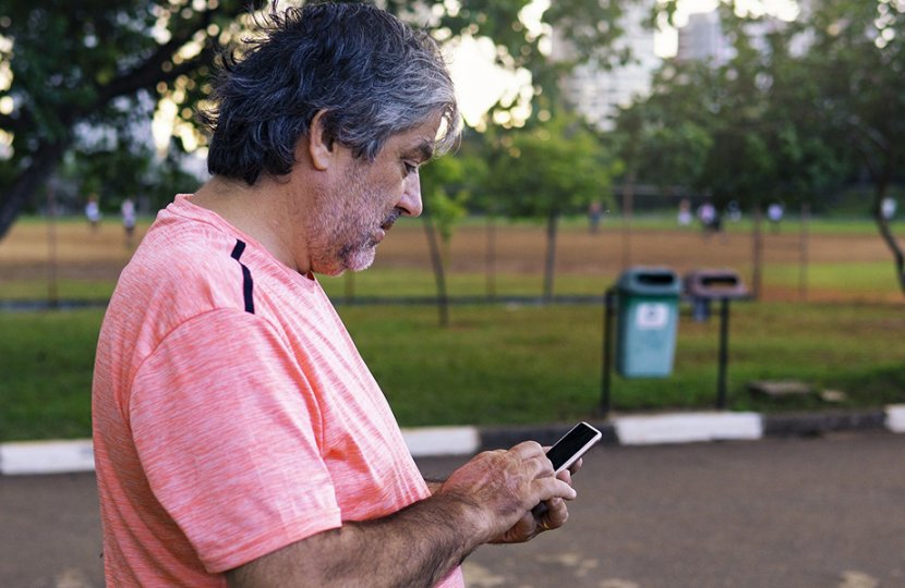 Image of elderly man using a cellphone