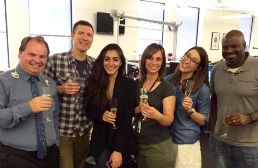 Los Angeles Times staff celebrate the Pulitzer on April 18, including USC Annenberg graduates Sarah Parvini (third from left) and Laura Nelson (fifth from left). Photo courtesy of Laura Nelson.