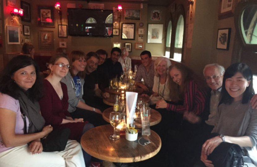 In this photo from the Annenberg Networks Network website, Professors Janet Fulk (fourth from right) and Peter Monge (second from right) meet with students and colleagues from Northwestern University and Georgia Tech.