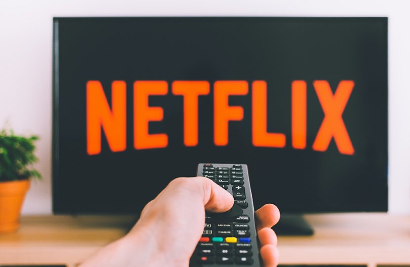 Photo of Netflix on a television and a remote control