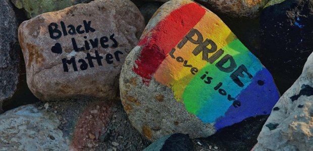 """Picture of painted rocks that read """"Black Lives Matter"""" and one with a rainbow with the words """"Pride"""" and """"Love is love"""""""