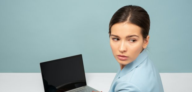 Photo of a person using a laptop