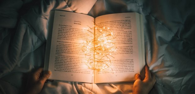 Photo of an open book with a string of lights in it