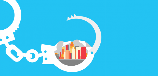 Illustration depicting handcuffs with one of them open encompassing a city