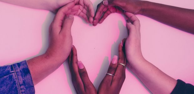 Photo of hands forming a heart