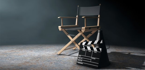 Photo of a chair next to a film clapperboard