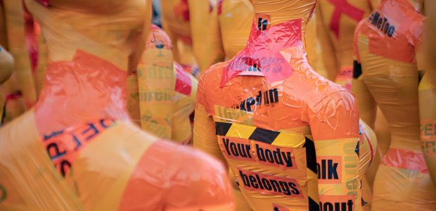 """Image of mannequins wrapped in caution tape and other material. One reads """"Your body belongs to you"""""""