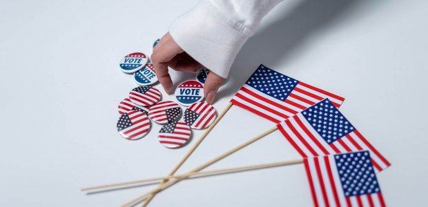 Photo of American flag pins and American flag souvenirs on a table